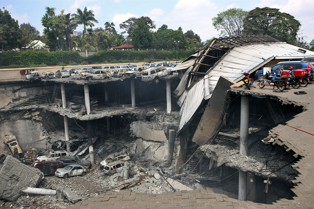 . This photo released by the Kenya Presidency shows the collapsed upper car park of the Westgate Mall in Nairobi, Kenya Thursday, Sept. 26, 2013. Working near bodies crushed by rubble in a bullet-scarred, scorched mall, FBI agents continued fingerprint, DNA and ballistic analysis to help determine the identities and nationalities of victims and al-Shabab gunmen who attacked the shopping center, killing more than 60 people. (AP Photo/Kenya Presidency)