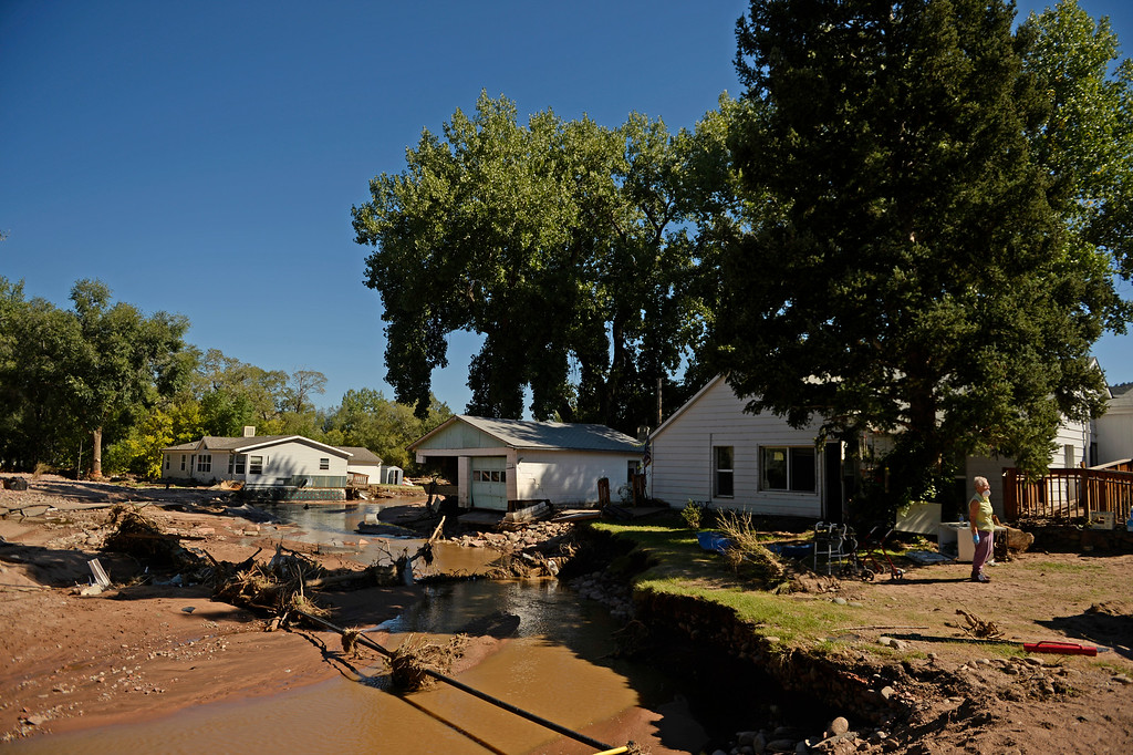 . Avis Livingston, 65, who has lived in the Lyons area her whole life, stands out infront of her flood damaged home in Lyons, September 20, 2013. Residents start to clean up after a massive flood hit the area. (Photo By RJ Sangosti/The Denver Post)