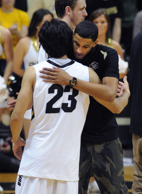 . Andre Roberson hugs Sabatino Chen (23) after the Buffs lost to Oregon State.    (Cliff Grassmick/Boulder Daily Camera)