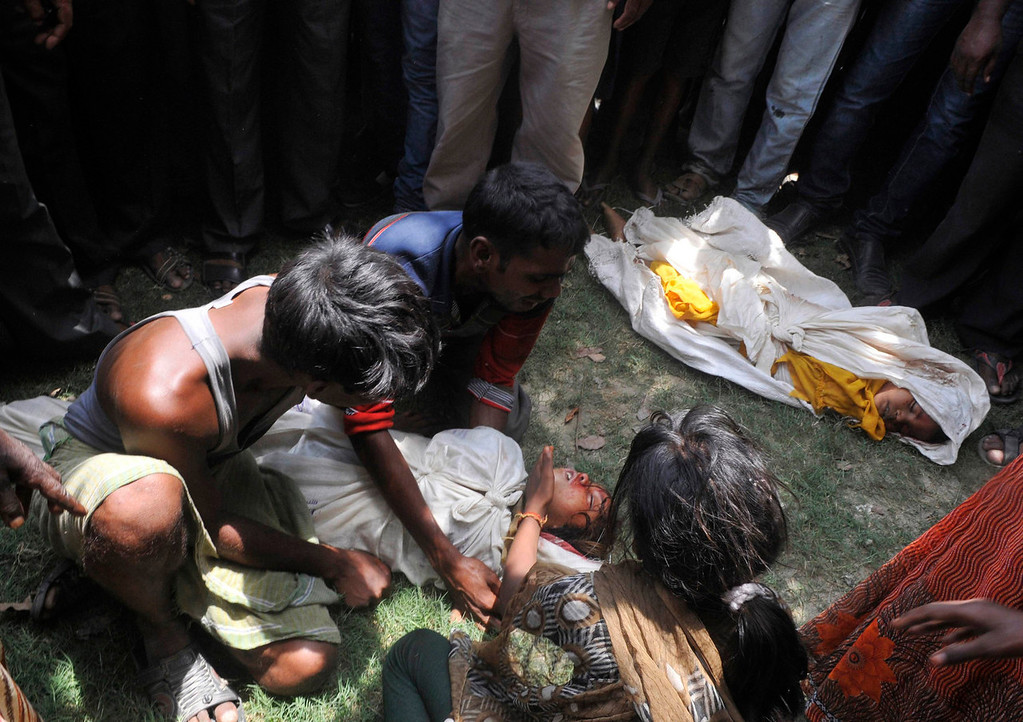 . A man weeps while holding the body of his child who died after consuming contaminated meals given to children at a school at Chapra in the eastern Indian state of Bihar on Tuesday, July 17, 2013. At least 25 Indian children died and dozens needed hospital treatment after apparently being poisoned by a school meal, sparking violent protests and angry allegations of blame. The school, at Mashrakh village in the district of Chapra, provided free meals under the Mid-Day Meal Scheme, the world\'s largest school feeding program involving 120 million children. Medical teams treating the children said they suspected the food had been contaminated with insecticide. REUTERS/Stringer