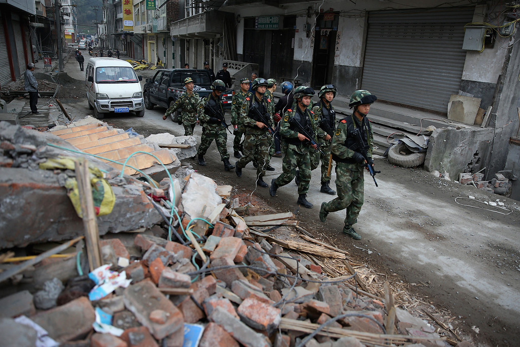 . Chinese policemen patrol on April 22, 2013 in Baoxing county of Ya An, China.  A magnitude 7 earthquake hit China\'s Sichuan province on April 20 claiming over 190 lives and injuring thousands.  (Photo by Feng Li/Getty Images)