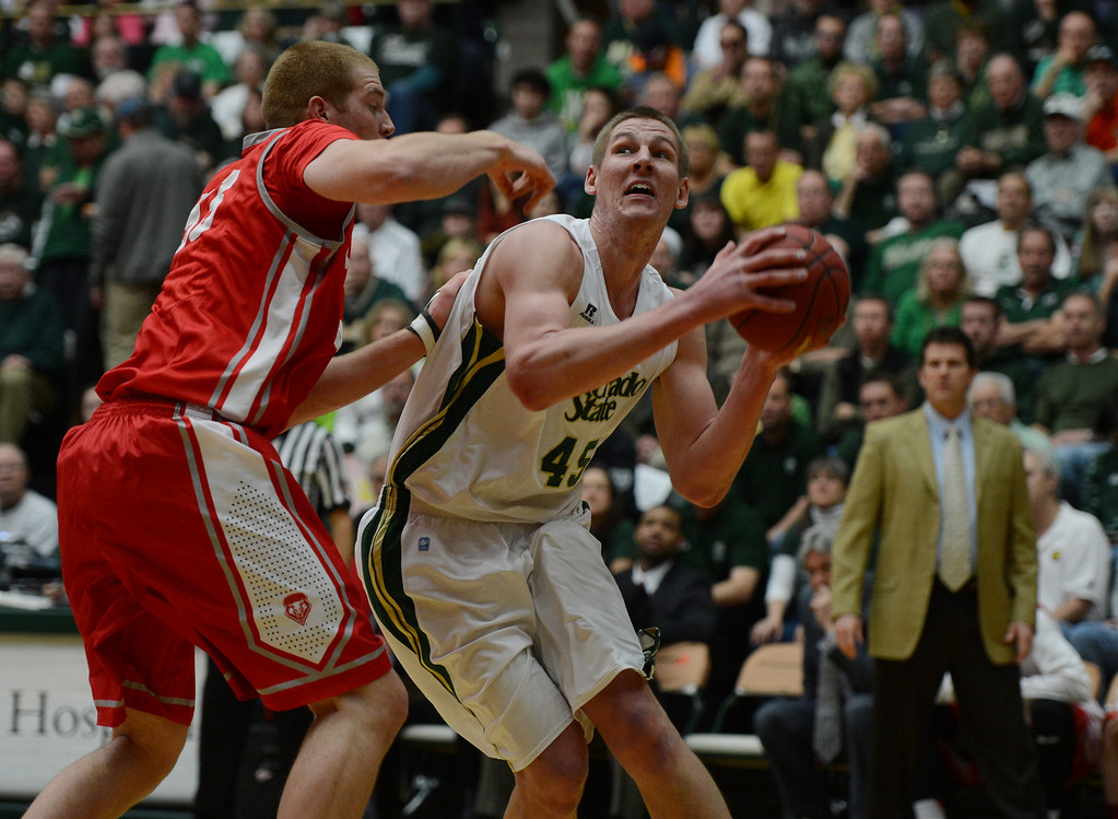 . Fort COLLINS, CO. - FEBRUARY 23: Colorado State Colton Iverson goes up New Mexico Alex Kirk during the first half action at Moby Arena in Fort Collin, CO February  24, 2013. The Colorado State Rams mens basketball team took on the New Mexico Lobos. (Photo By Craig F. Walker/The Denver Post)