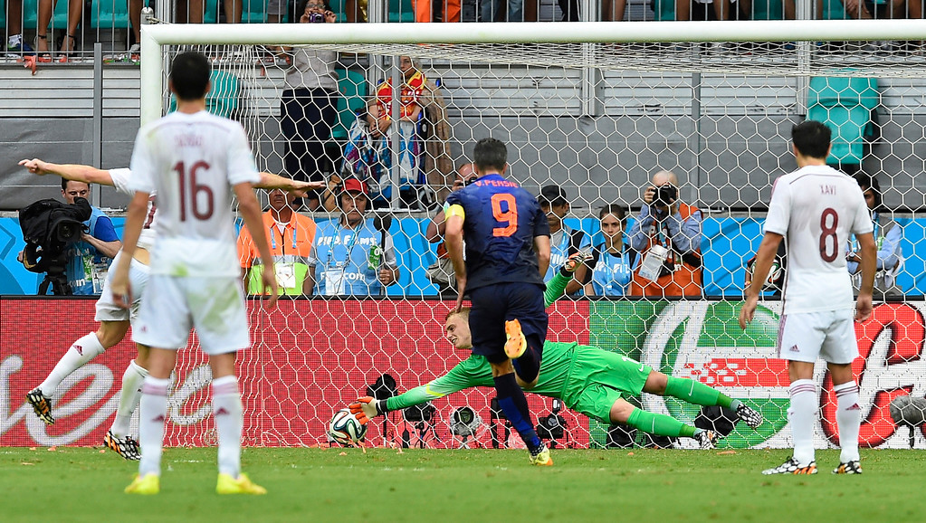 . Spain\'s Xabi Alonso, obscured at left, scores past Netherlands\' goalkeeper Jasper Cillessen from the penalty spot during the group B World Cup soccer match between Spain and the Netherlands at the Arena Ponte Nova in Salvador, Brazil, Friday, June 13, 2014. (AP Photo/Manu Fernandez)