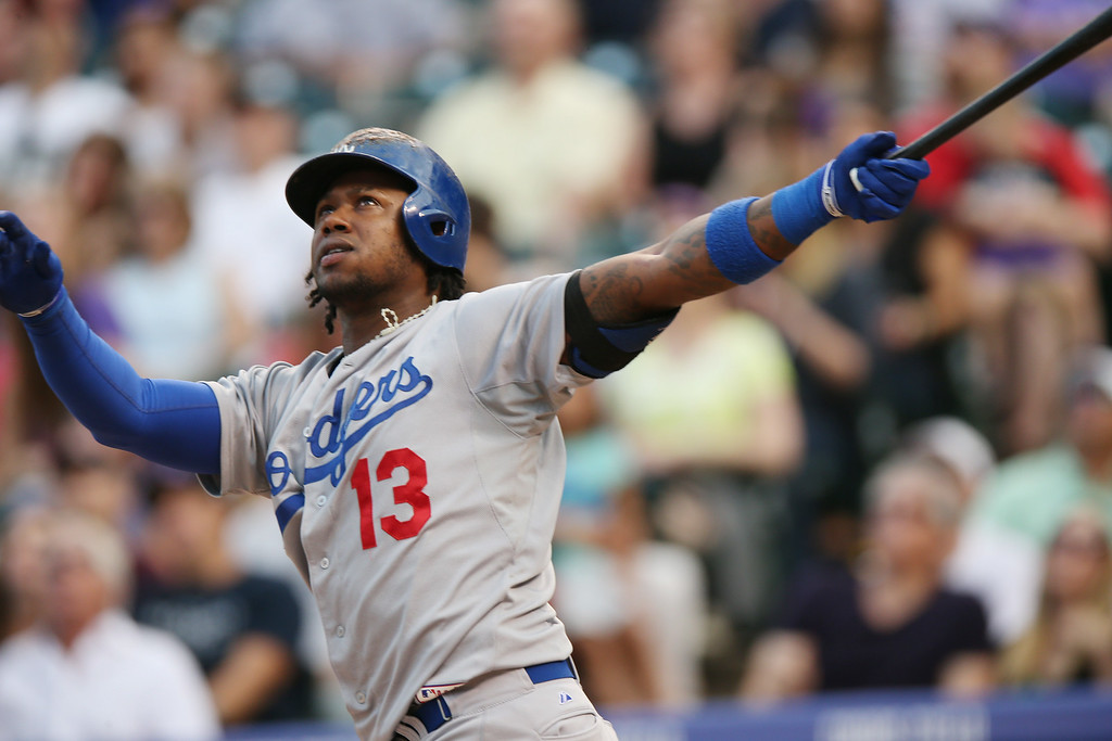 . Los Angeles Dodgers\' Hanley Ramirez follows the flight of his out in the fifth inning of a baseball game against the Colorado Rockies in Denver, Thursday, July 3, 2014. (AP Photo/David Zalubowski)
