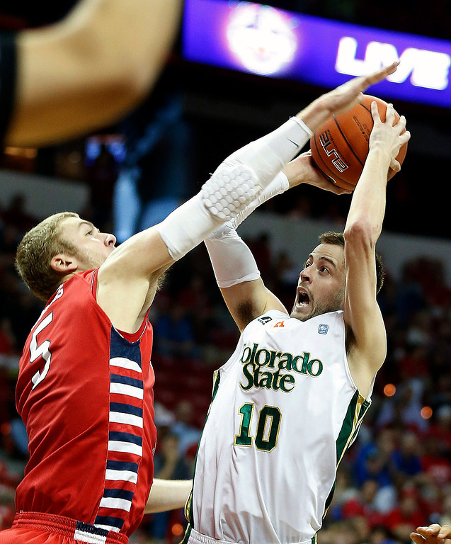 . Fresno State\'s Tanner Giddings, left, covers a shot from Colorado State\'s Wes Eikmeier during the second half of a Mountain West Conference tournament NCAA college basketball game on Wednesday, March 13, 2013, in Las Vegas. Colorado State defeated Fresno State 67-61. (AP Photo/Isaac Brekken)