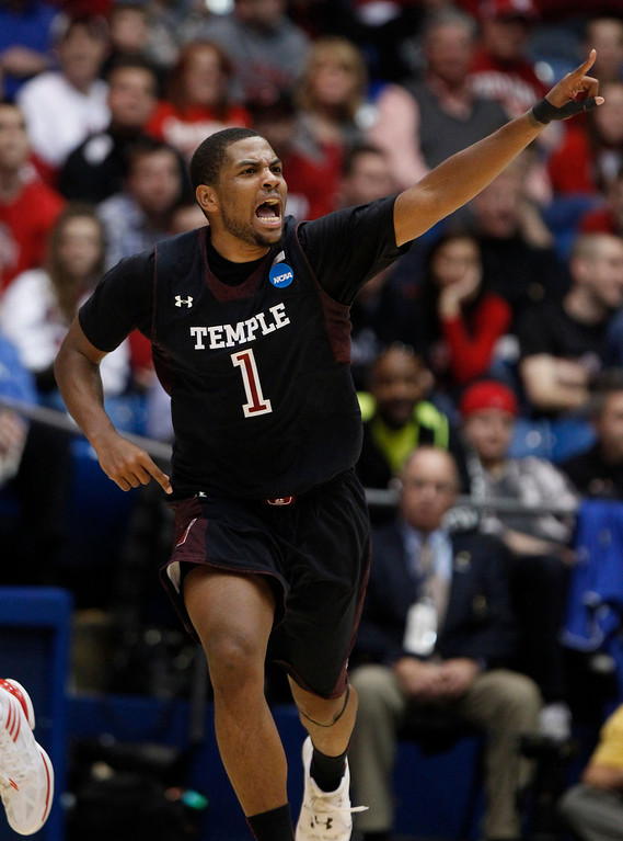 . Temple\'s Khalif Wyatt (1) heads back down the floor after scoring a 3-pointer in the second half of Temple\'s 76-72 victory over North Carolina State in the second round of the NCAA Tournament Friday, March 22, 2013, at the University of Dayton Arena in Dayton, Ohio. (Ethan Hyman/Raleigh News & Observer/MCT)
