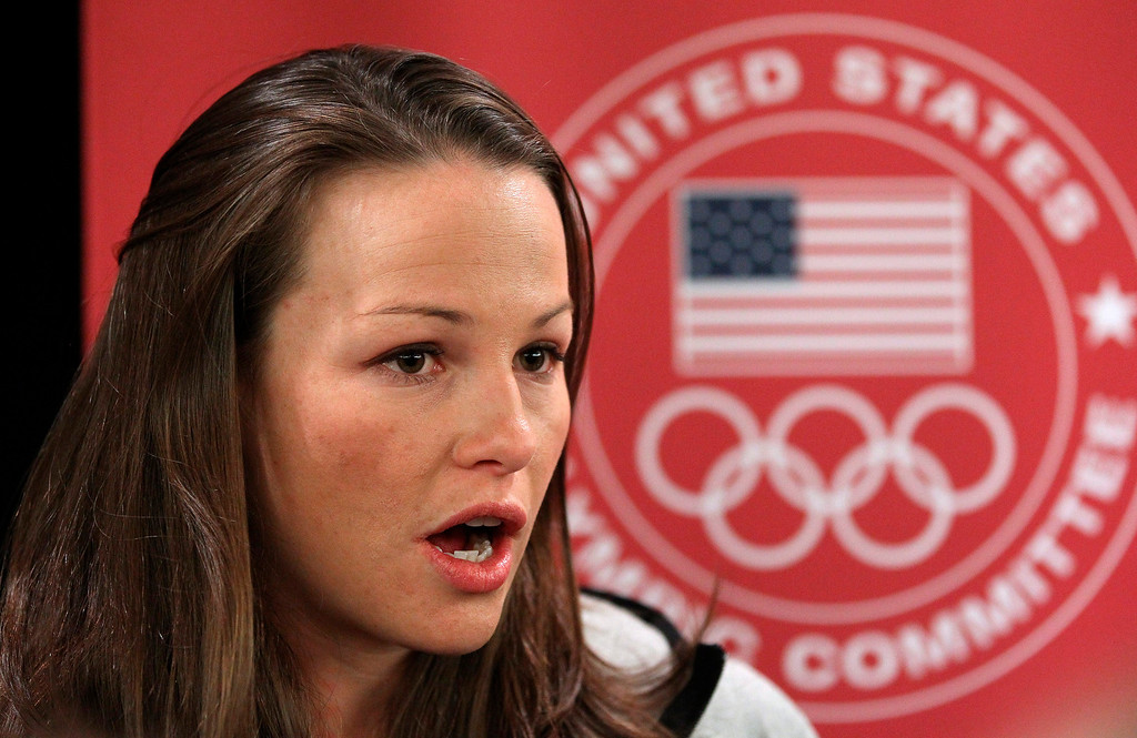 . Ski-jumper Lindsey Van speaks with reporters during a news conference at the U.S. Olympic Committee media summit Tuesday, Oct. 1, 2013, in Park City, Utah. (AP Photo/Rick Bowmer)