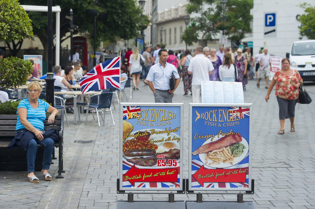 . Food advertising boards are displayed on Casemates square in Gibraltar on August 13, 2013. This rock of seven square kilometers enclosed in the coast of Andalusia, off the tip of southern Spain, is reminiscent of England: the red phone booths, mailboxes Royal Mail, the lampposts decorated with flowers, and double decker buses.   MARCOS MORENO/AFP/Getty Images