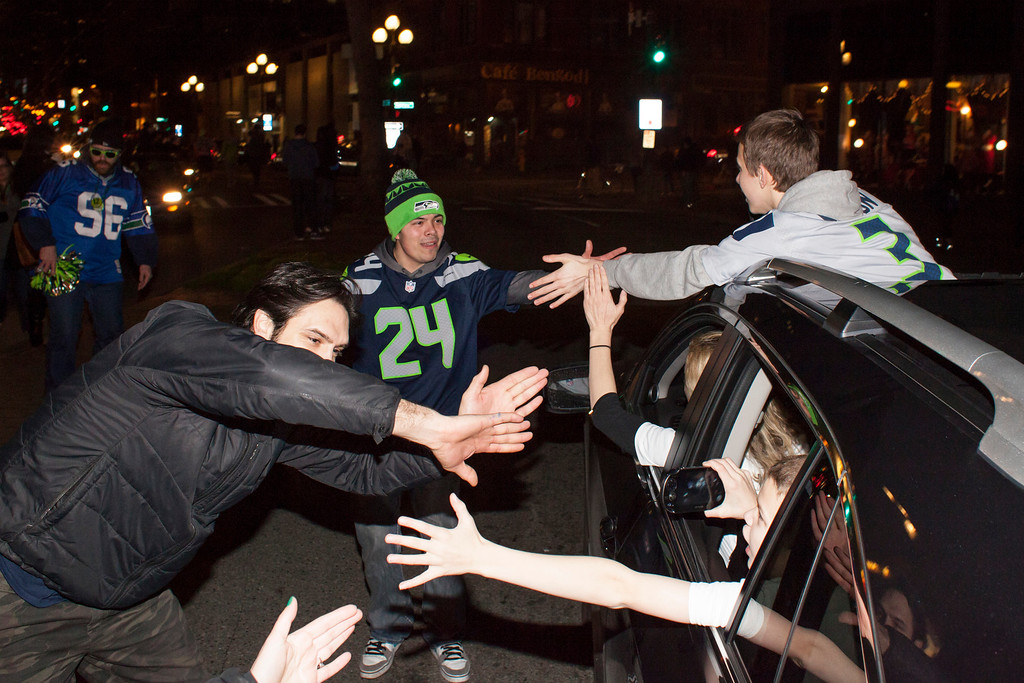 . Seattle Seahawks fans celebrate after watching their team win the Super Bowl on February 2, 2014 in Seattle, Washington. The Seahawks defeated the Denver Broncos 43-8 in Super Bowl XLVIII.  (Photo by David Ryder/Getty Images)