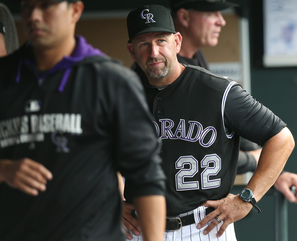 . Colorado Rockies manager Walt Weiss looks on from dugout as his team falls behind the Minnesota Twins in the eighth inning of the Twins\' 9-3 victory in an interleague baseball game in Denver on Saturday, July 12, 2014. (AP Photo/David Zalubowski)