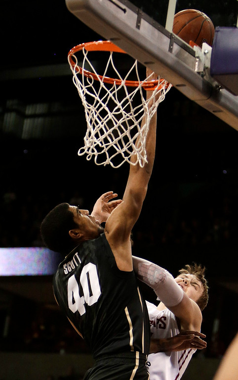 . Washington State\'s Josh Hawkinson, right, attempts a layup against Coloradoís Josh Scott (40) during the first half of an NCAA college basketball game Wednesday, Jan. 8, 2014, in Spokane, Wash. (AP Photo/Young Kwak)