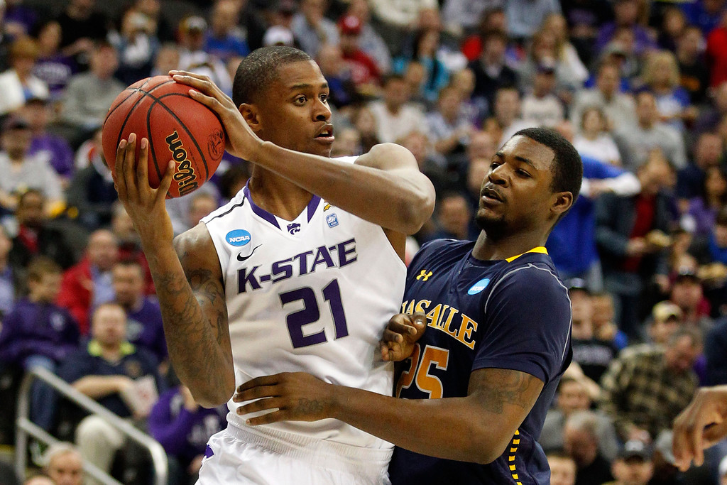 . KANSAS CITY, MO - MARCH 22: Jordan Henriquez #21 of the Kansas State Wildcats looks to pass against Jerrell Wright #25 of the La Salle Explorers in the first half during the second round of the 2013 NCAA Men\'s Basketball Tournament at the Sprint Center on March 22, 2013 in Kansas City, Missouri.  (Photo by Ed Zurga/Getty Images)