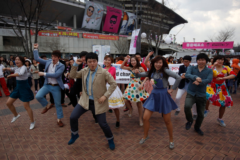 """. A South Korean dance team performs Psy\'s \""""Gangnam Style\"""" horseriding dance during a flashmob to celebrate Psy\'s new song \""""Gentleman\"""" at the Seoul World Cup stadium, the venue for Psy\'s concert \""""happening\"""" in Seoul April 13, 2013. Psy will perform \""""Gentleman\"""" in public for the first time on Saturday at a concert at Seoul\'s World Cup stadium but he has been coy about what dance to expect this time, except to hint that it is based on traditional Korean moves. Psy released his new single on Thursday hoping to repeat the success of \""""Gangnam Style\"""" that made him the biggest star to emerge from the growing K-pop music scene.   REUTERS/Kim Hong-Ji"""