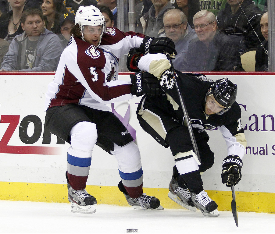 . Chuck Kobasew #12 of the Pittsburgh Penguins handles the puck in front of Nate Guenin #5 of the Colorado Avalanche during the game at Consol Energy Center on October 21, 2013 in Pittsburgh, Pennsylvania.  (Photo by Justin K. Aller/Getty Images)