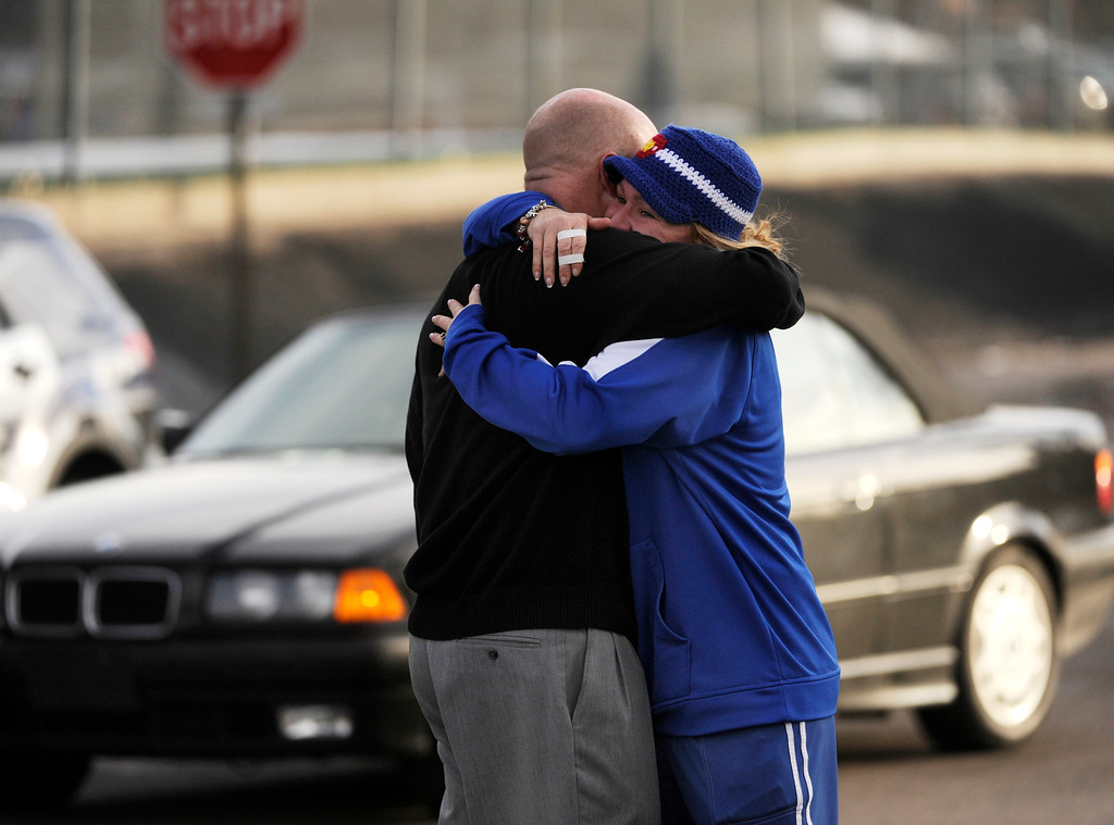. CENTENNIAL, CO. - DECEMBER 13: Susie Ohle hugged Rob Escue as he came out of Arapahoe High School Friday afternoon, December 13, 2013. A shooting inside the school sent hundreds of students and teachers rushing for safety. Photo By Karl Gehring/The Denver Post