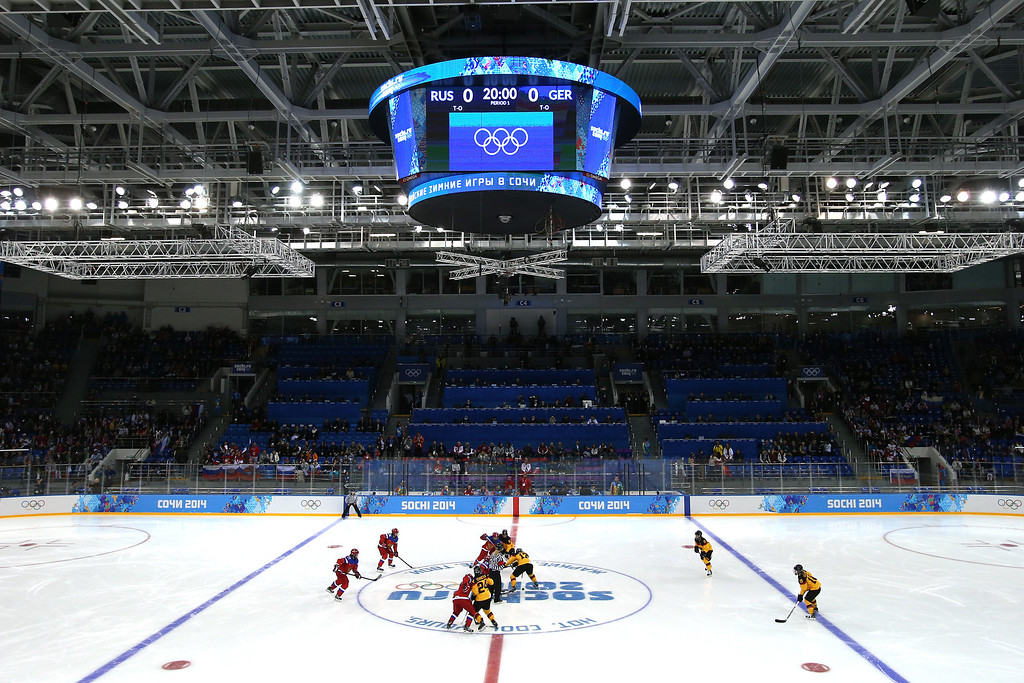 . SOCHI, RUSSIA - FEBRUARY 09:  Tatyana Burina #23 of Russia faces off against Sara Seiler #17 of Germany during the Women\'s Ice Hockey Preliminary Round Group B Game on day two of the Sochi 2014 Winter Olympics at Shayba Arena on February 9, 2014 in Sochi, Russia.  (Photo by Bruce Bennett/Getty Images)