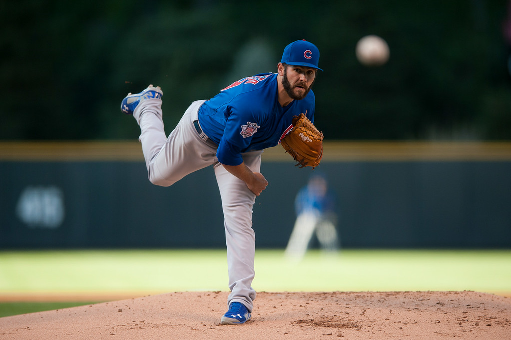 . DENVER, CO - AUGUST 06:  Jake Arrieta #49 of the Chicago Cubs pitches against the Colorado Rockies in the first inning of a game at Coors Field on August 6, 2014 in Denver, Colorado.  (Photo by Dustin Bradford/Getty Images)
