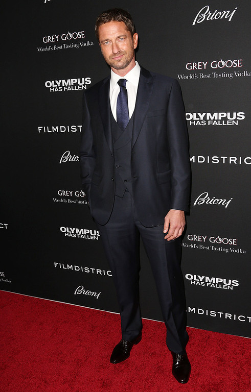 """. Actor Gerard Butler attends the Premiere of FilmDistrict\'s \""""Olympus Has Fallen\"""" at the ArcLight Cinemas Cinerama Dome on March 18, 2013 in Hollywood, California.  (Photo by Frederick M. Brown/Getty Images)"""