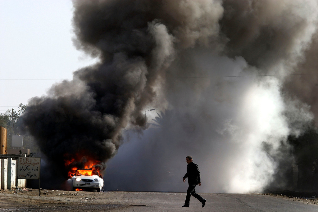 . A car bomb went off next to a school in south of Baghdad one hour after a suicide bomber targeted a police station in the same area on January 28, 2005, Baghdad, Iraq. Baghdad was witnessing a surge of violence as the country prepared for elections. (Photo by Ghaith Abdul-Ahad/Getty Images).