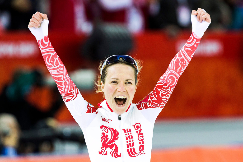 . Bronze medallist Olga Graf of Russia celebrates after the Women\'s 3000m Speed Skating event in the Adler Arena at the Sochi 2014 Olympic Games, Sochi, Russia, 09 February 2014.  EPA/HANNIBAL HANSCHKE