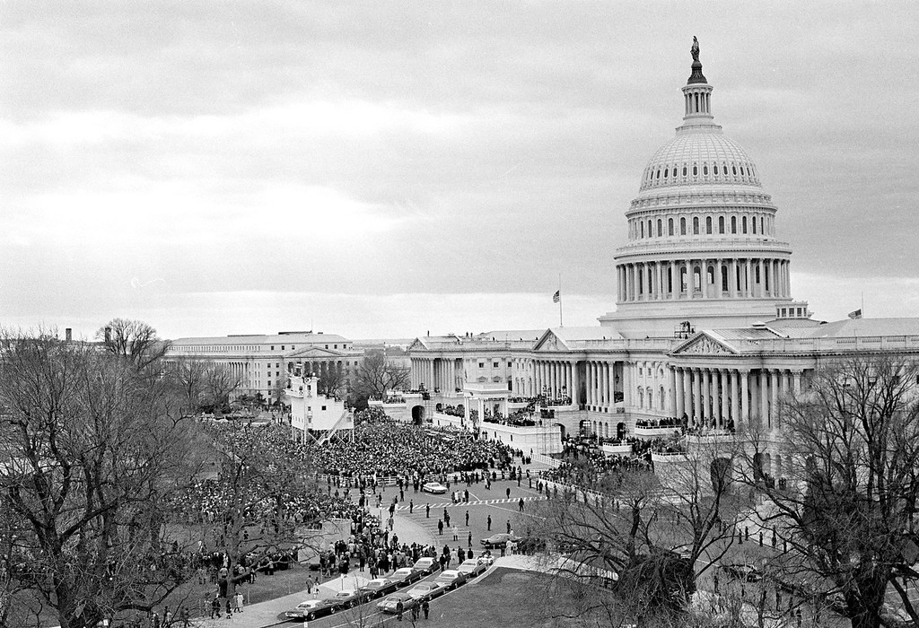 . The east side of the Capitol Building is the setting today as President Richard Nixon is sworn in for a second term in Washington, D.C., Jan. 20, 1973. The American flag is at half mast to honor the late President Harry S. Truman. (AP Photo)