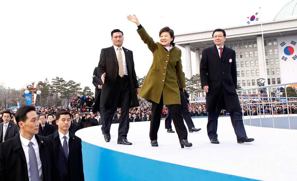 . South Korea\'s new President Park Geun-hye waves as she leaves after her inauguration at parliament in Seoul, South Korea, Monday, Feb. 25, 2013. Elected in December, Park is believed to be the first Korean woman to rule in a millennium. (AP Photo/Kim Hong-Ji, Pool)
