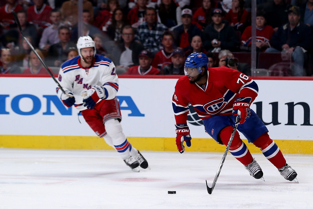. MONTREAL, QC - MAY 17:  P.K. Subban #76 of the Montreal Canadiens with the puck in front of Dominic Moore #28 of the New York Rangers in the second period in Game One of the Eastern Conference Finals of the 2014 NHL Stanley Cup Playoffs at the Bell Centre on May 17, 2014 in Montreal, Canada.  (Photo by Bruce Bennett/Getty Images)
