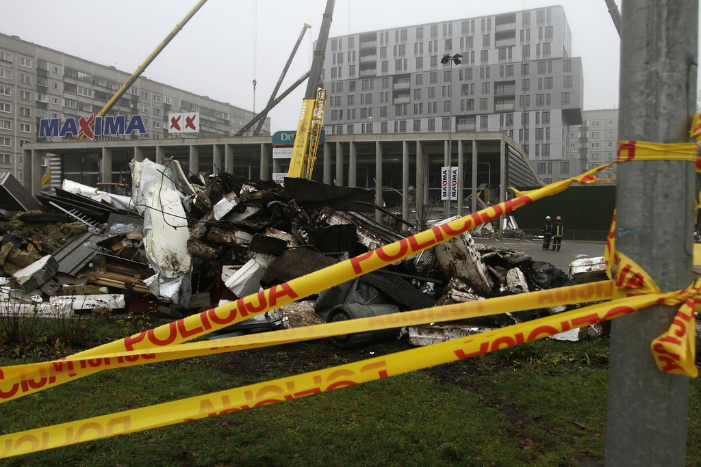 . Police tape cordons off an area around the Maxima supermarket as rescue work is underway after its roof collapsed, in Riga, Latvia, 22 November 2013.  EPA/VALDA KALNINA
