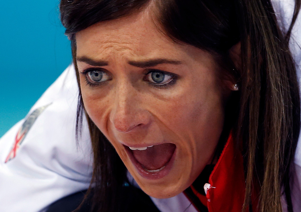 . Britain\'s skip Eve Muirhead shouts instructions to her sweepers as they approach the house during women\'s curling competition against Russia at the 2014 Winter Olympics, Monday, Feb. 17, 2014, in Sochi, Russia. (AP Photo/Robert F. Bukaty)