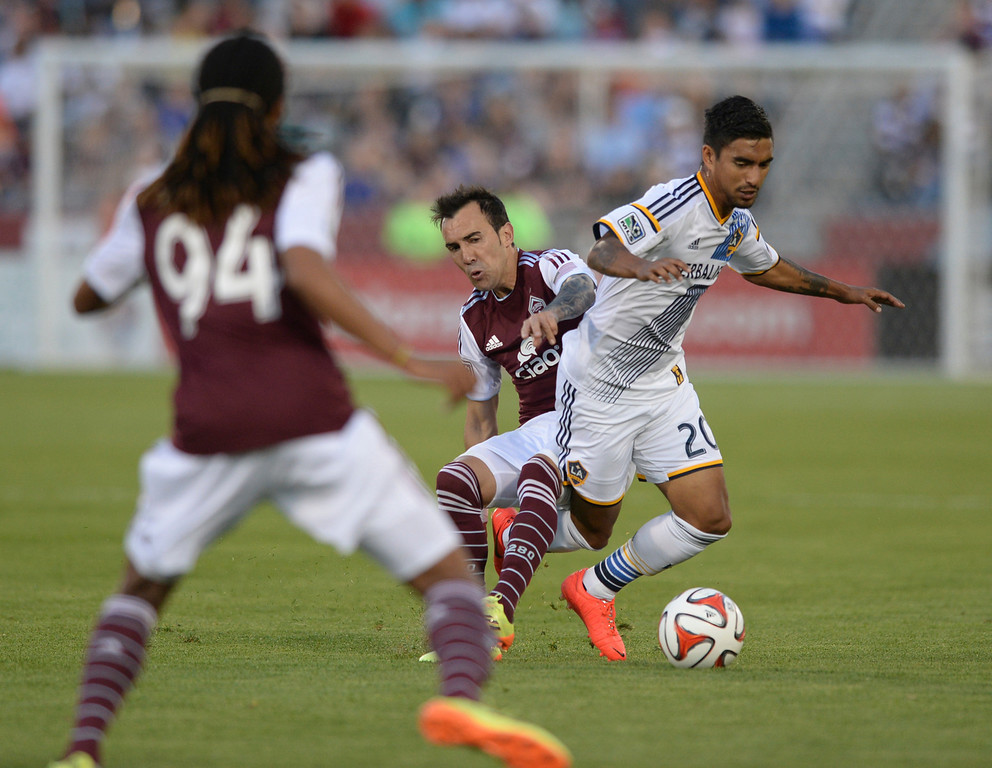 . COMMERCE CITY, CO - MAY 3:  Colorado forward Vicente Sanchez (7) tripped up Galaxy defender A.J. DeLaGarza (20) in the first half. The Colorado Rapids hosted the Los Angeles Galaxy Saturday night, May 3, 2014 at Dick\'s Sporting Good Park. (Photo by Karl Gehring/The Denver Post)