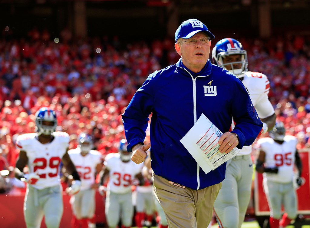 . KANSAS CITY, MO - SEPTEMBER 29:  Head coach Tom Coughlin of the New York Giants leads the team onto the field prior to the game against the Kansas City Chiefs at Arrowhead Stadium on September 29, 2013 in Kansas City, Missouri.  (Photo by Jamie Squire/Getty Images)