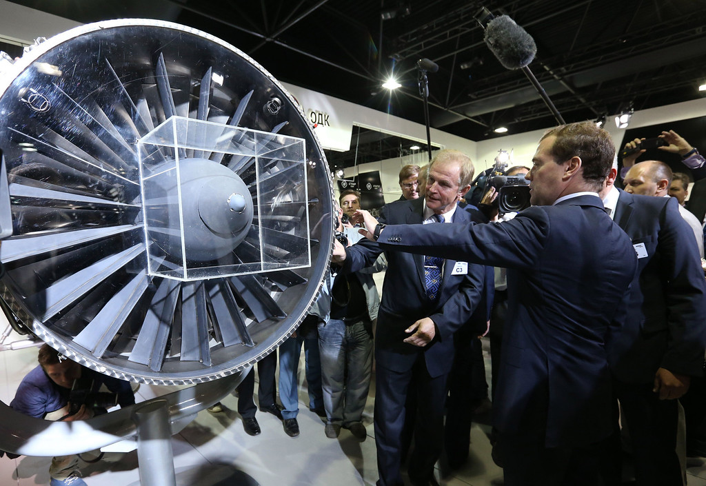 . Russia\'s Prime Minister Dmitry Medvedev (R) listen to explanations at the stand of the United Engine-Building Corporation ODK as he visits the pavilion of the United Industrial Corporation Obornprom at the MAKS International Aviation and Space Salon in Zhukovsky outside Moscow on August 27, 2013. AFP PHOTO / RIA NOVOSTI / POOL / EKATERINA SHTUKINA/AFP/Getty Images