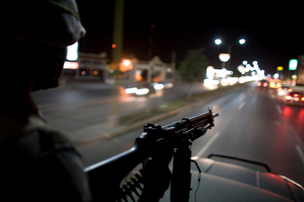 . In this March 17, 2009 file photo, Mexican soldiers patrol the streets of Reynosa, on Mexico\'s northeastern border with the United States. On March 10, 2013, heavy gunfire echoed along the main thoroughfare and across several neighborhoods in a firefight that lasted for hours, leaving perforated and burned vehicles scattered across the border city. Social media exploded with reports of dozens dead. Witnesses saw at least 12, but an official count showed only a couple of deaths. (AP Photo/Alexandre Meneghini, File)