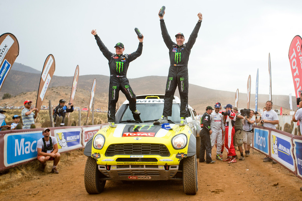 """. Joan \""""Nani\"""" Roma of Spain, right, and co-pilot Michel Perin of France, left, celebrate on top of their Mini after winning the 2014 Dakar Rally at the end of the special of the thirteenth stage in Illapel, Chile, Saturday, Jan. 18, 2014. (AP Photo/Victor R. Caivano)"""