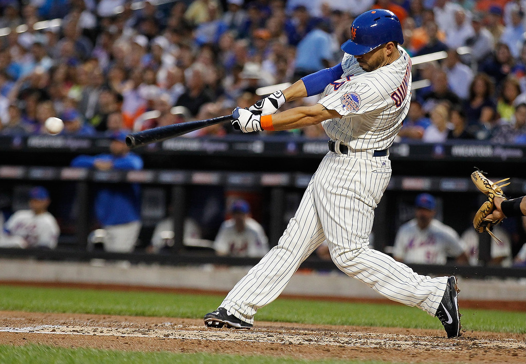 . Omar Quintanilla #3 of the New York Mets hist a RBI single in the second inning against the Colorado Rockies at Citi Field on August 7, 2013 at Citi Field in the Flushing neighborhood of the Queens borough of New York City.  (Photo by Mike Stobe/Getty Images)