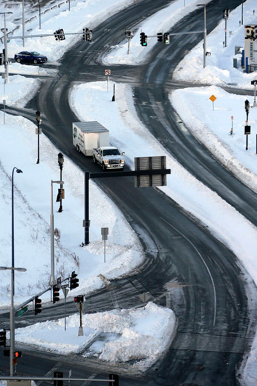 . The roads in the Seaport area of Boston are clear and open early Sunday morning, Feb. 10, 2013. A snow storm dumped more than two-feet of snow in the area Friday night and Saturday. (AP Photo/Gene J. Puskar)