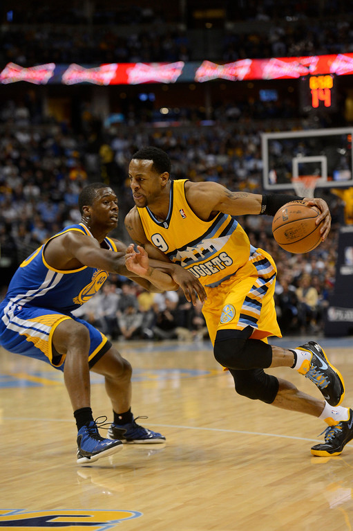 . DENVER, CO. - APRIL 23: Denver Nuggets shooting guard Andre Iguodala (9) drives to the basket against Golden State Warriors small forward Harrison Barnes (40) in the first quarter. The Denver Nuggets took on the Golden State Warriors in Game 2 of the Western Conference First Round Series at the Pepsi Center in Denver, Colo. on April 23, 2013. (Photo by John Leyba/The Denver Post)
