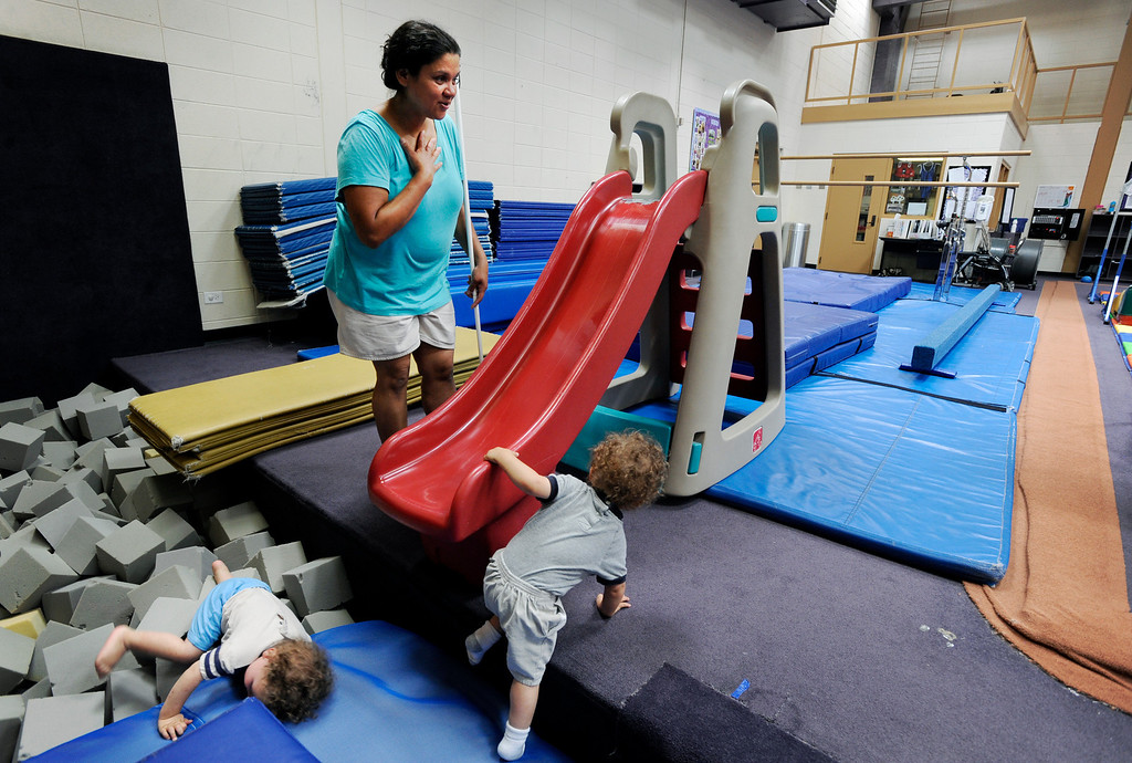 . Ena Batron plays with her 21-month-old twins at a Littleton recreation center during one of her five children\'s gymnastics classes in Littleton, Colo. Ena keeps busy with her children, attending Mothers of Preschoolers, rec center classes and other events in the family\'s community. Ena and Brent Batron are both blind, and raising five kids under the age of 10.  Photo by Jamie Cotten, Special to The Denver Post