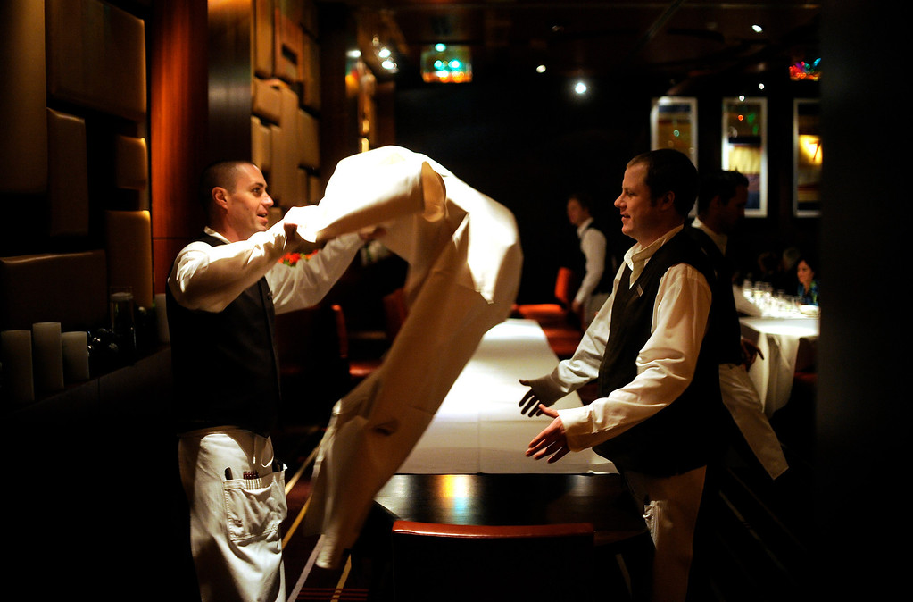 . Elway\'s downtown inside the Ritz Carlton located at 1881 Curtis St. in Denver on December 8, 2012.  Ben Marshall and Billy Furbush, right, close down the private dinning area at Elway\'s at the Ritz Carlton.  Photo by Evan Semón, For The Denver Post