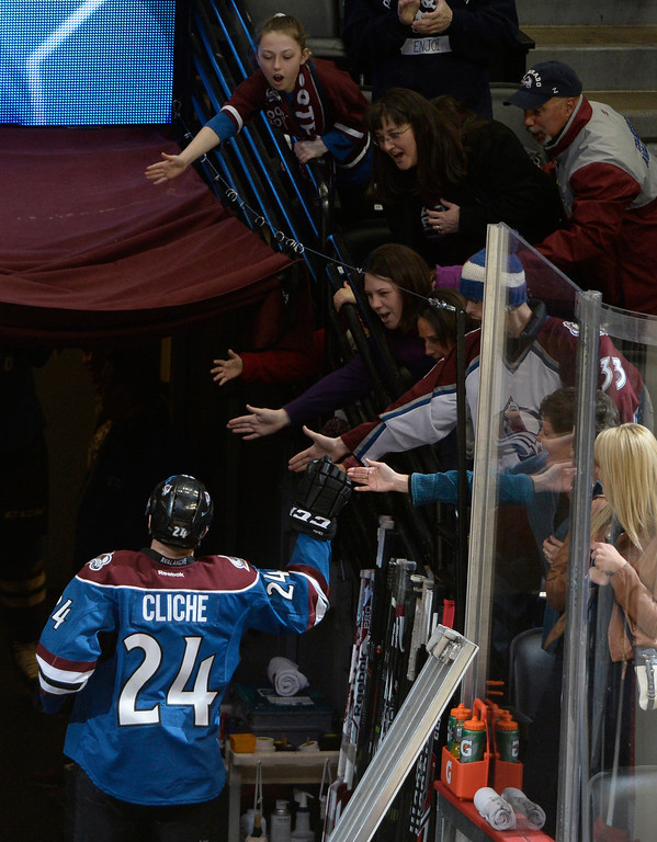 . Colorado Avalanche center, Marc-Andre Cliche, gets congratulations from fans coming off the ice after being recognized as one of the players of the game Saturday afternoon, February 01, 2014. The Avalanche won 7-1, Cliche scored his first NHL goal.  (Photo By Andy Cross / The Denver Post)