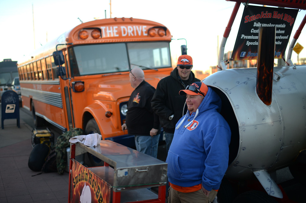 . DENVER, CO. JANUARY 18: From left, Rob Wynne, Ryan Swanson and Kevin Campbell are tailgating at South side of Sports Authority Field at Mile High Denver. Colorado. January 18. 2014. (Photo by Hyoung Chang/The Denver Post)