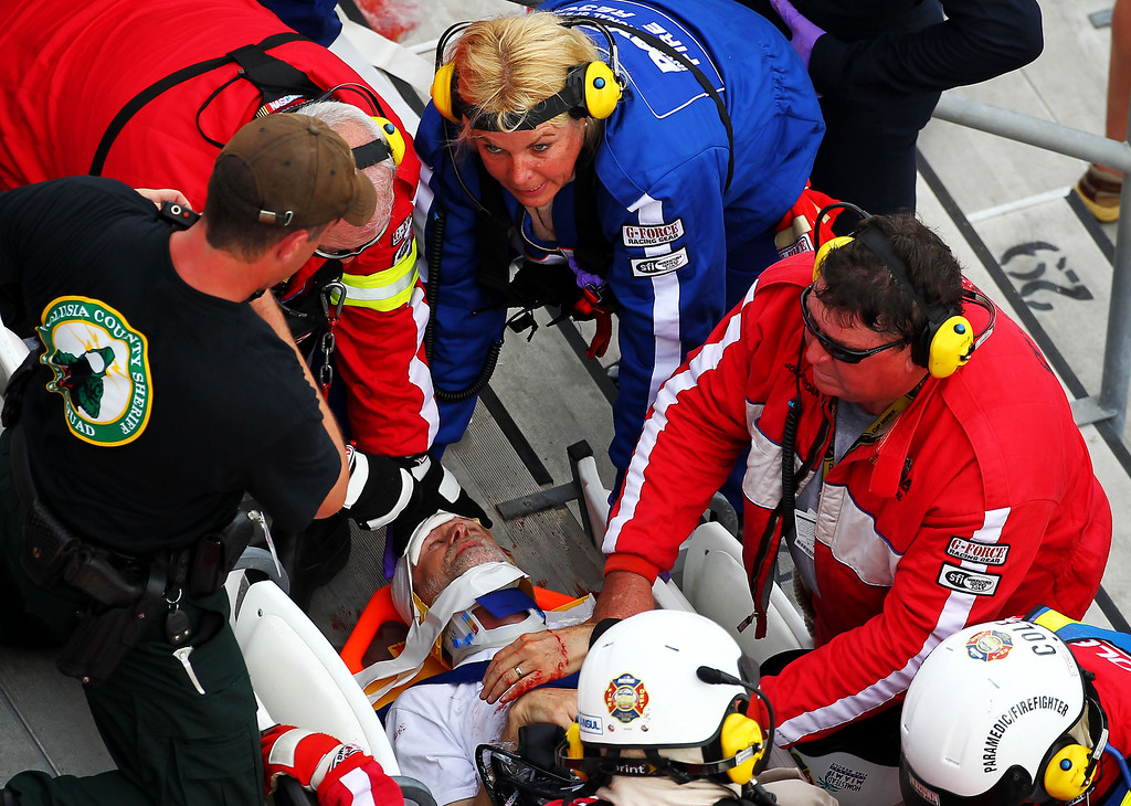 . DAYTONA BEACH, FL - FEBRUARY 23:  Medical officials remove an injured fan from the stands following an incident at the finish of  the NASCAR Nationwide Series DRIVE4COPD 300 at Daytona International Speedway on February 23, 2013 in Daytona Beach, Florida.  (Photo by Jonathan Ferrey/Getty Images)