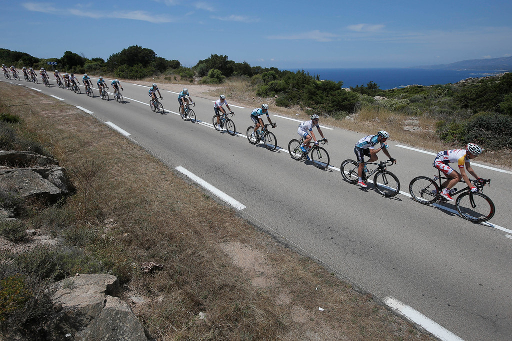 . The pack rides along the coast line of the Mediterranean Sea during the first stage of the 100th edition of the Tour de France cycling race over 213 kilometers (133 miles) with start in Porto Vecchio and finish in Bastia, Corsica island, France, Saturday June 29, 2013.(AP Photo/Laurent Cipriani)