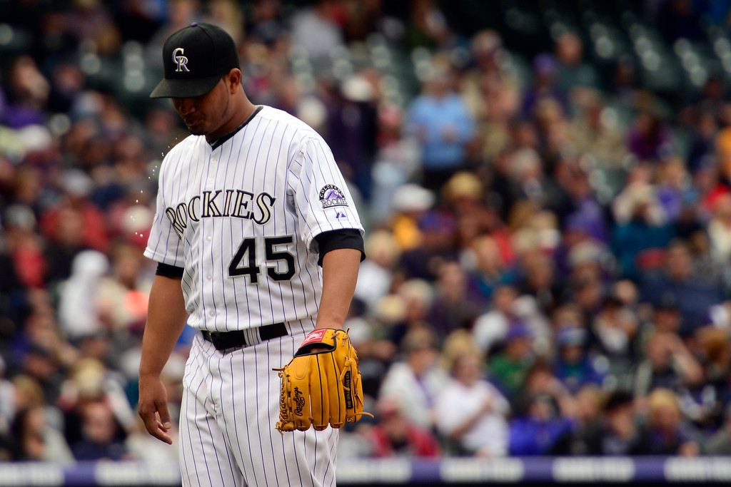 . DENVER, CO - MAY 5: Jhoulys Chacin (45) of the Colorado Rockies walks off the field after the sixth inning against the Tampa Bay Rays during the Rockies 8-3 loss.   (Photo by AAron Ontiveroz/The Denver Post)