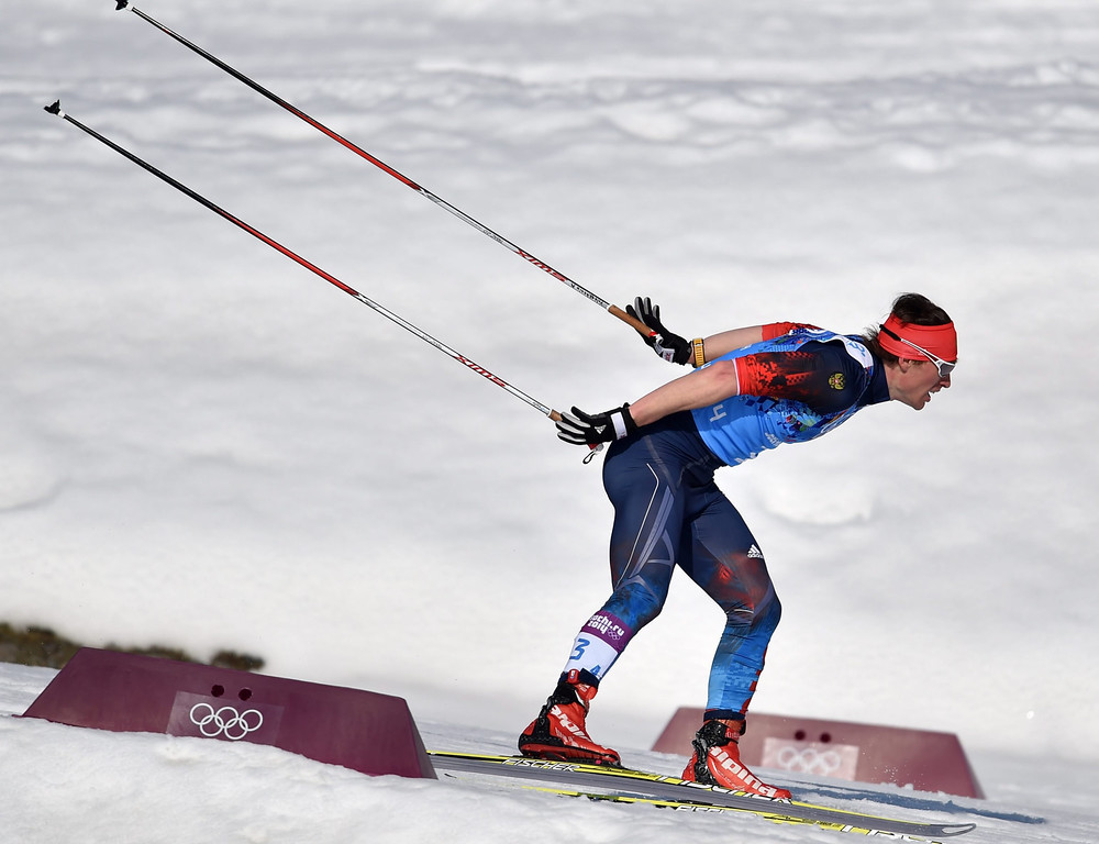 . Silver medalist Maxim Vylegzhanin of Russia of France in action during the Men\'s 4 X 10km Relay competition at the Laura Cross Country Center during the Sochi 2014 Olympic Games, Krasnaya Polyana, Russia, 16 February 2014.  EPA/HENDRIK SCHMIDT