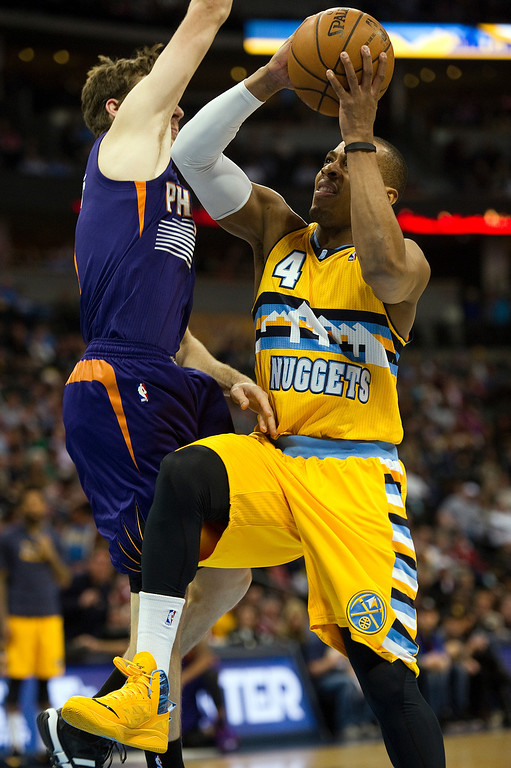 . DENVER, CO - DECEMBER 20: Randy Foye #4 of the Denver Nuggets drives for a basket against Goran Dragic #1 of the Phoenix Suns during the second quarter of an NBA game at the Pepsi Center on December 20, 2013, in Denver, Colorado. (Photo by Daniel Petty/The Denver Post)