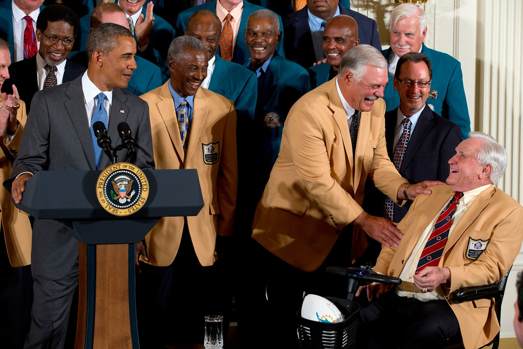 . From left, Miami Dolphins football running back Mercury Morris, President Barack Obama, wide receiver Paul Warfield, watch as fullback Larry Csonka, and coach Don Shula share a laugh during a ceremony in the East Room of the White House in Washington, Tuesday, Aug. 20, 2013, where the president honored the Super Bowl VII football champions Dolphins forty-one years after their perfect football season. The 1972 Miami Dolphins remain the only undefeated team in NFL history. (AP Photo/Jacquelyn Martin)
