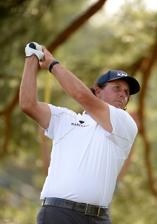 . Phil Mickelson of the United States hits his tee shot on the eighth hole during Round Three of the 113th U.S. Open at Merion Golf Club on June 15, 2013 in Ardmore, Pennsylvania.  (Photo by Ross Kinnaird/Getty Images)