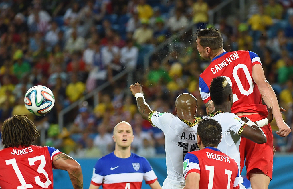 . yew (C) and US midfielder Jermaine Jones, US midfielder Alejandro Bedoya and US defender Geoff Cameron jump for the ball during a Group G football match between Ghana and US at the Dunas Arena in Natal during the 2014 FIFA World Cup on June 16, 2014.  EMMANUEL DUNAND/AFP/Getty Images