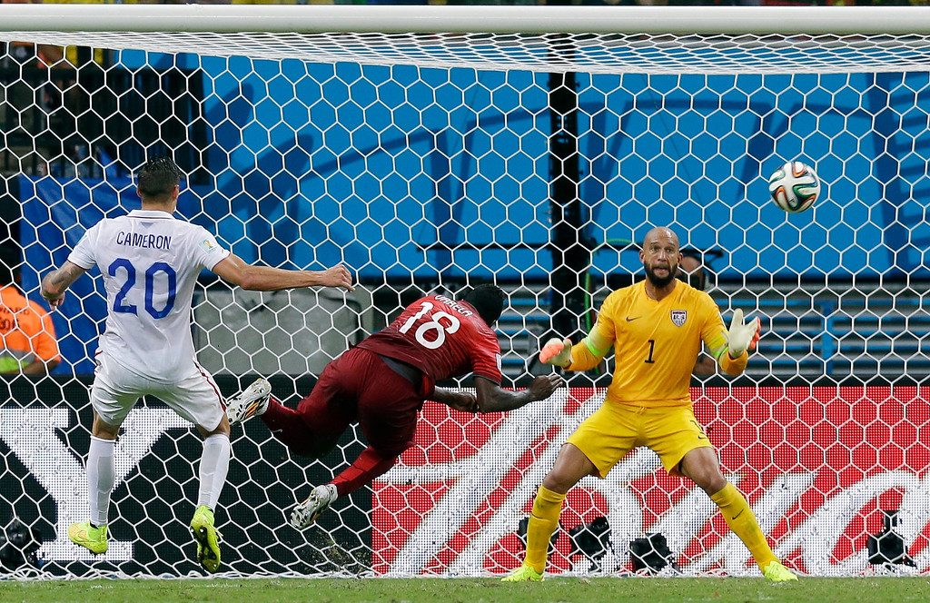 . Portugal\'s Silvestre Varela heads the ball past United States\' goalkeeper Tim Howard to score his side\'s second goal and tie the game 2-2 during the group G World Cup soccer match between the USA and Portugal at the Arena da Amazonia in Manaus, Brazil, Sunday, June 22, 2014. (AP Photo/Martin Mejia)